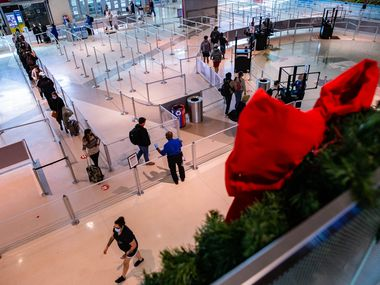 Travelers wait in the security line at Dallas Love Field Airport in Dallas on Wednesday, Nov. 25, 2020. (Juan Figueroa/ The Dallas Morning News)