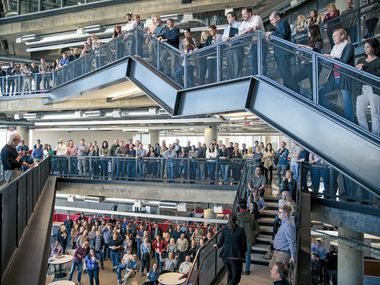Richards Group employees gathered at the three-story atrium staircase in the ad agency's headquarters on Jan. 19, 2019.
