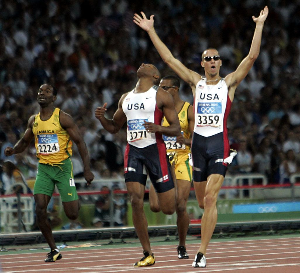 2004 Summer Olympic Games: Jeremy Wariner (3359) of the U.S. beats teammate Otis Harris to the finish line to win the men's 400m final during track and field competition at the 2004 Summer Olympic Games in Athens, Greece, on Aug. 23, 2004.