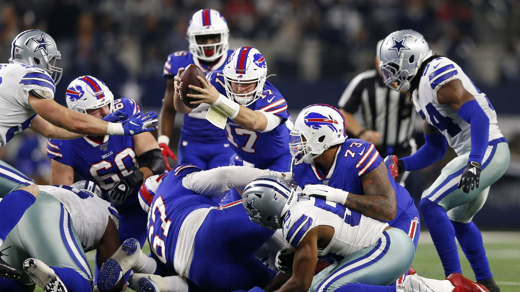 Buffalo Bills quarterback Josh Allen (17) dives for a first down in a game against the Dallas Cowboys during the first half of play at AT&T Stadium in Arlington, Texas on Thursday, November 28, 2019. (Vernon Bryant/The Dallas Morning News)