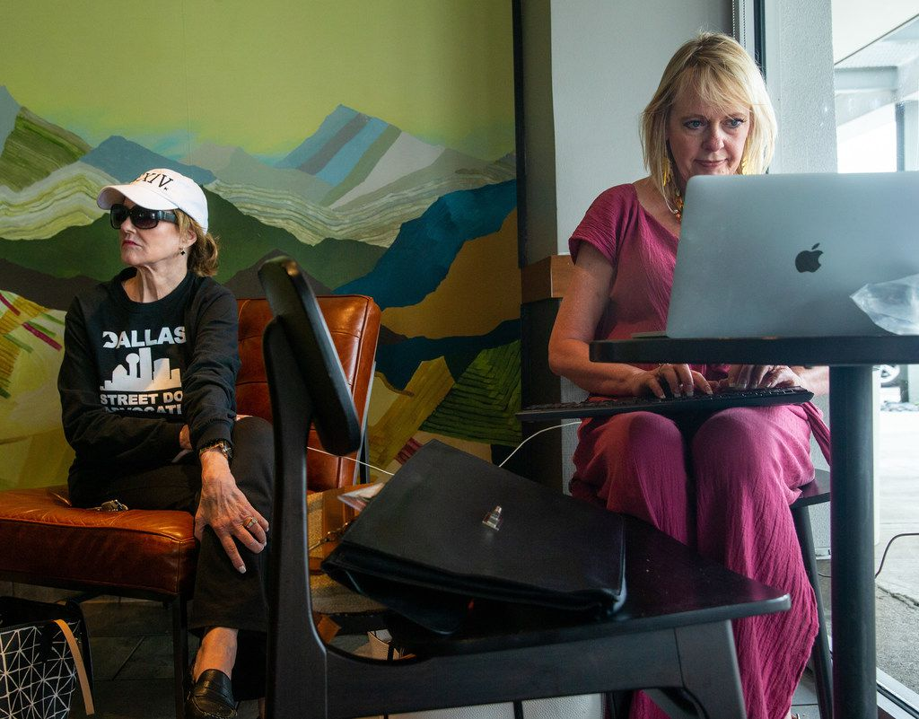 Jenene Justice (left), and Beverly Smirnis, residents whose power has yet to be restored since Sunday's storm, charged their electronics at a Starbucks coffee shop on Preston Road in Dallas on Tuesday.