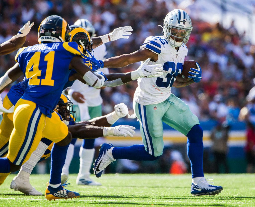 Dallas Cowboys running back Tony Pollard (36) stiff arms Los Angeles Rams defenders during the first quarter of an NFL preseason game between the Dallas Cowboys and the Los Angeles Rams on Friday, August 17, 2019 at Aloha Stadium in Honolulu, Hawaii. (Ashley Landis/The Dallas Morning News)