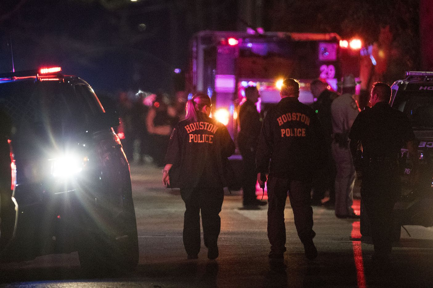 Police investigate Monday night after several officers were shot.