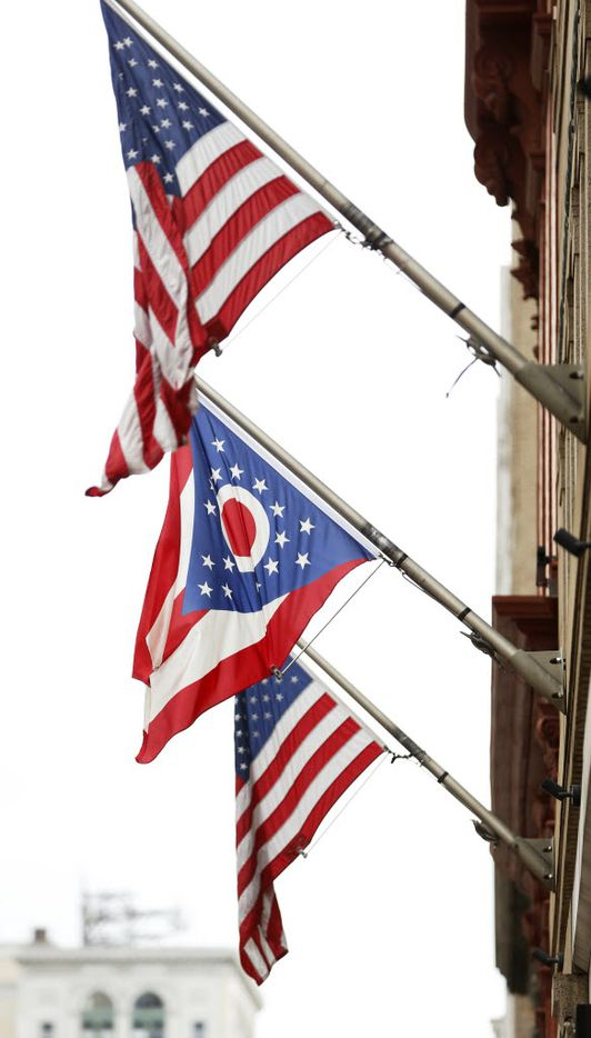 Ohio state flag in between two USA flags in downtown Cleveland, Ohio on Saturday, July 16, 2016. The city is hosting the Republican National Convention. (Vernon Bryant/The Dallas Morning News)