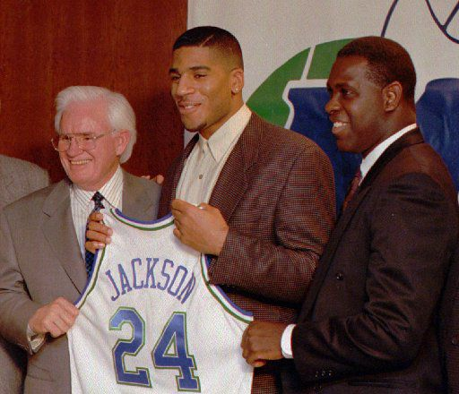Dallas Mavericks owner Donald Carter, left, poses with first round draft pick Jim Jackson, center, and new coach Quinn Buckner at a news conference in Dallas Thursday.  Buckner won't start until next season.  Jackson will play against the Houston Rockets in Friday's game in Dallas. (AP Photo)