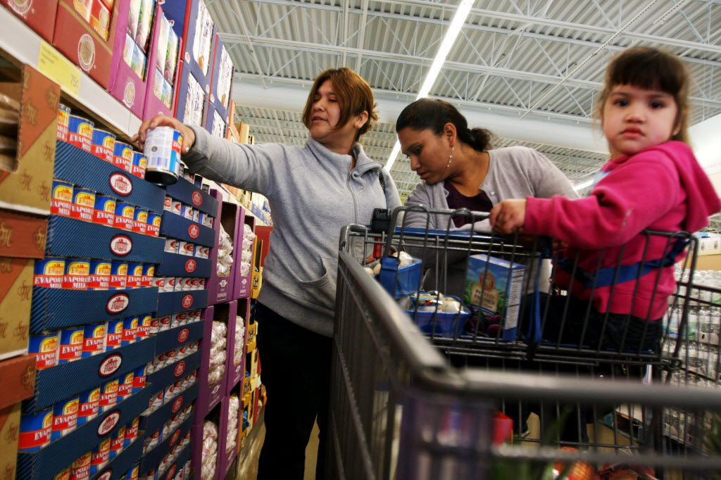 Francisca Aniceto (left) and Dominga Jaimes, originally from Michoacan, Mexico, look through canned foods at the Aldi grocery store in Garland. (2010 File Photo/Special Contributor)