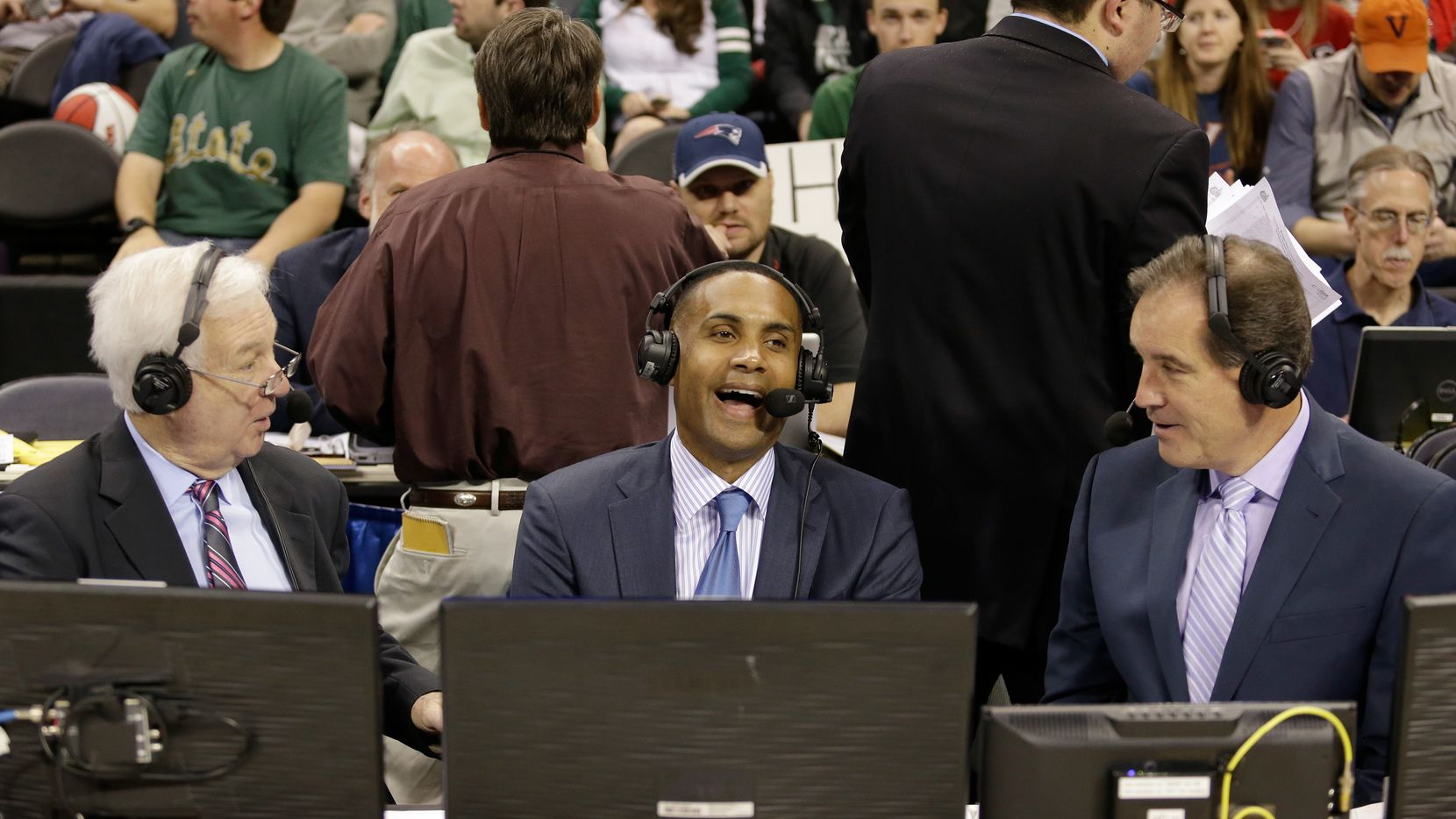CHARLOTTE, NC - MARCH 20:  (L-R) College basketball analysts, Bill Raftery, Grant Hill, and Jim Nance watch on during the game between the Georgia Bulldogs and Michigan State Spartans during the second round of the 2015 NCAA Men's Basketball Tournament at Time Warner Cable Arena on March 20, 2015 in Charlotte, North Carolina.  (Photo by Bob Leverone/Getty Images)