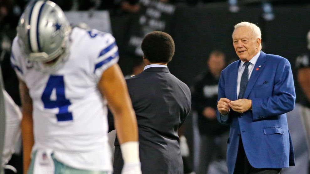 Dallas Cowboys owner Jerry Jones (right) is pictured on the field with Cowboys quarterback Dak Prescott (4) before a game against the Oakland Raiders at Oakland-Alameda County Coliseum in Oakland, Calif., on Sunday, Dec. 17, 2017.
