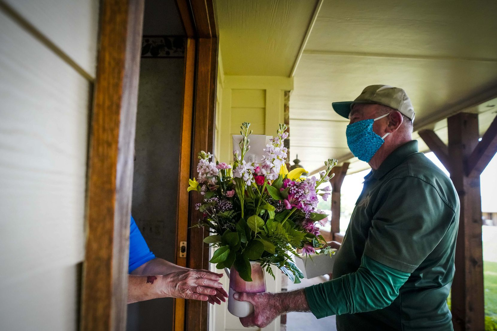 """Emmett Conoly of McShan Florist made a flower delivery for Mother's Day in Heath on May 9, 2020. Conoly, who spent 32 years as a Dallas firefighter, has been delivering flowers since 2006 and said he enjoys being able to help connect people to their loved ones. """"That's the main thing, I think, they are getting something from somebody who is thinking about them, it makes them feel good. It feels good to be part of it."""" McShan employs 17 regular delivery drivers and added 45 temporary drivers for Mother's Day."""