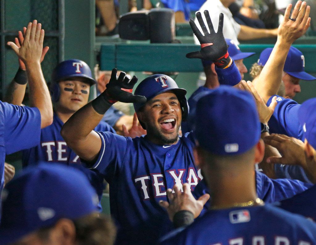 Texas Rangers shortstop Elvis Andrus (1) is congratulated by teammates after his home run in the sixth inning during the Seattle Mariners vs. the Texas Rangers major league baseball game at Globe Life Park in Arlington, Texas on Wednesday, August 2, 2017. (Louis DeLuca/The Dallas Morning News)