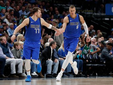 FILE - Mavericks guard Luka Doncic (77) and forward Kristaps Porzingis (6) celebrate a basket in the second half of a game against the Trail Blazers in Dallas on Sunday, Oct. 27, 2019.