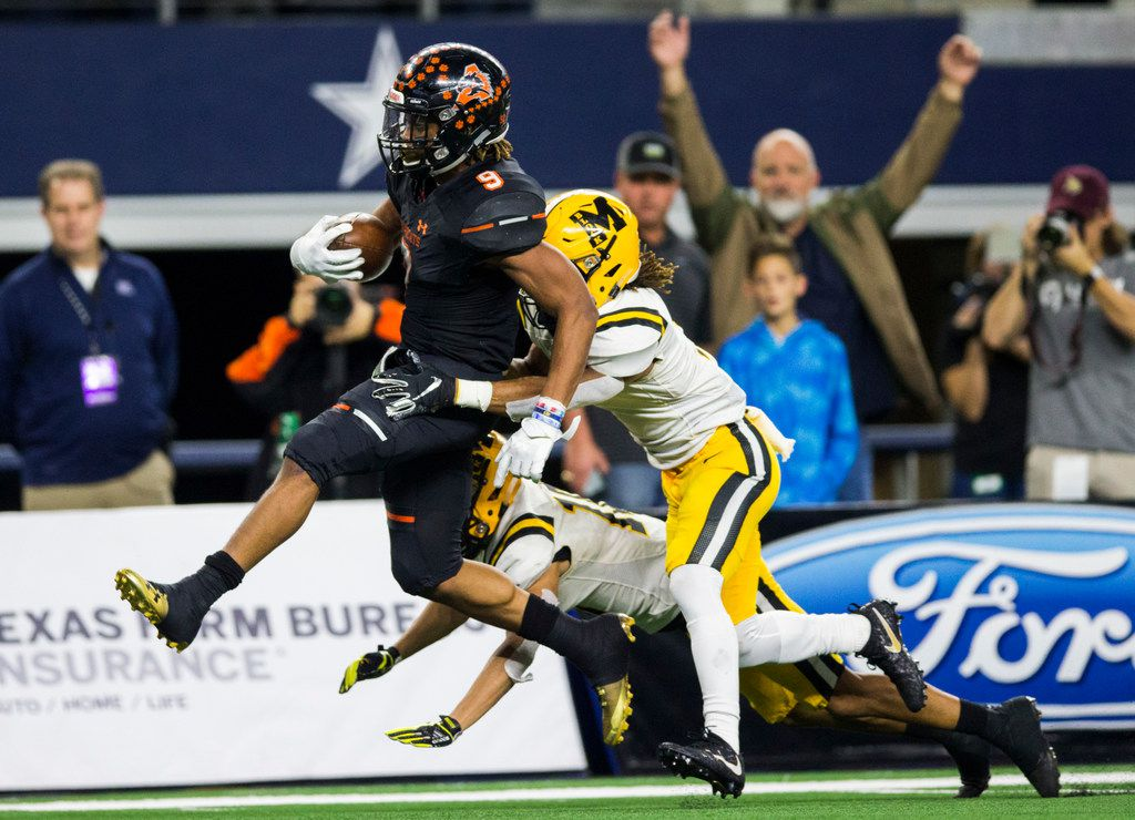 Aledo running back Jase McClellan (9) runs to the end zone for a touchdown while being tackled by Fort Bend Marshall defensive back Jaylon Wilson (7) during the second quarter of a UIL Class 5A Division II football state championship game between Aledo and Fort Bend Marshall on Friday, December 21, 2018 at AT&T Stadium in Arlington. (Ashley Landis/The Dallas Morning News)