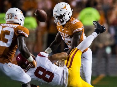 FILE - Texas defensive back B.J. Foster (25) tackles USC wide receiver Amon-Ra St. Brown (8), causing a fumble, during the fourth quarter of a game on Saturday, Sept. 15, 2018, at Darrell K Royal-Memorial Stadium in Austin. A penalty was called on Foster for targeting the receiver.