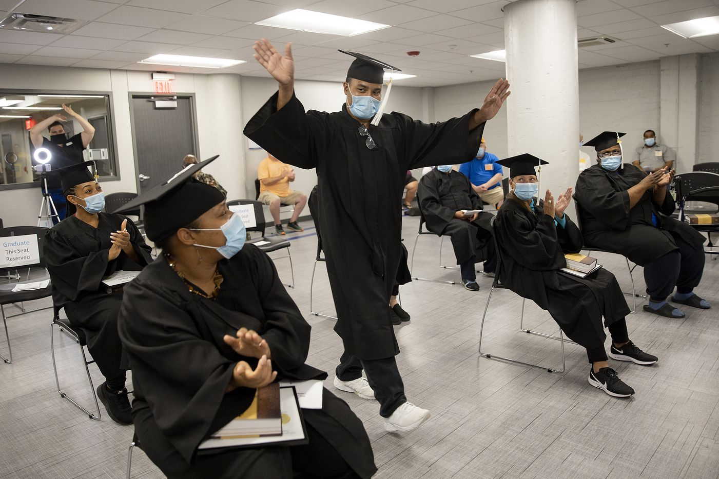 Daniel Wilson walks up to receive his certificate during the graduation ceremony for the September 2020 class of Dallas LIFE on Sept. 3, 2020 in Dallas. The graduates completed a 10-month program to help them overcome homelessness.