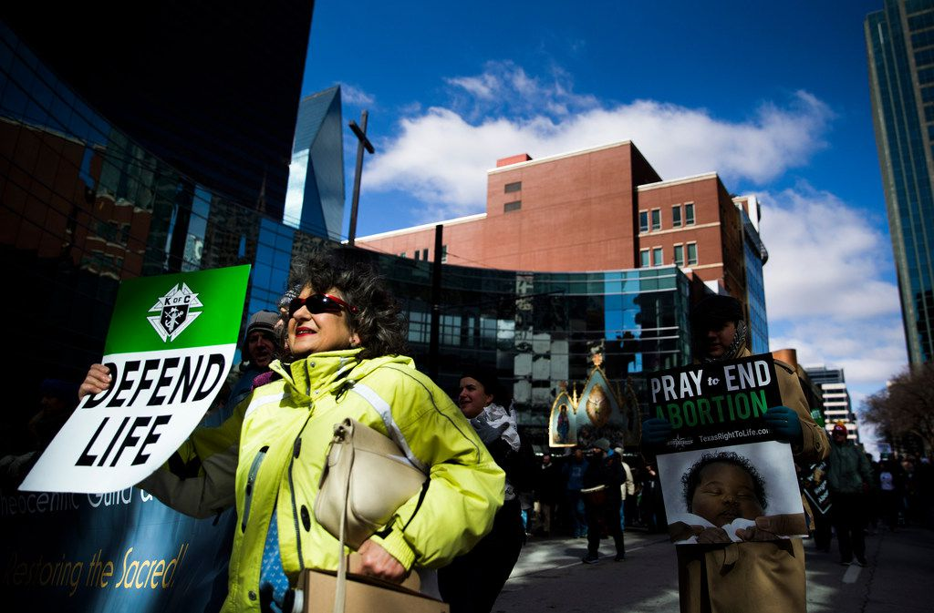 Demonstrators march from Cathedral Shrine of the Virgin of Guadalupe to Earle Cabell Federal Courthouse during the North Texas March for Life on Saturday, January 19, 2019 in downtown Dallas. Dallas is where the historic Roe v. Wade lawsuit was originally filed.