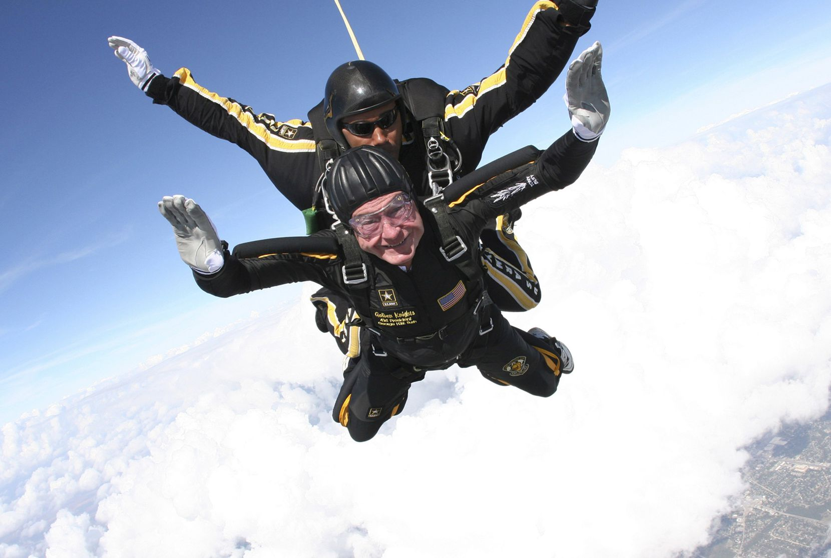 2007: Former President George H.W. Bush free-falls with U.S. Army Golden Knights parachute team member Sgt. 1st Class Mike Elliott as Bush made his entrance to his presidential museum during a rededication ceremony in College Station, Texas.
