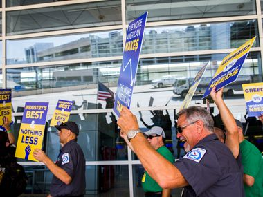 American Airlines employees protest the lack of a new contract for baggage carriers, mechanics and other staff on Wednesday, July 26, 2017 outside Terminal D at Dallas/Fort Worth International Airport. (Ashley Landis/The Dallas Morning News)