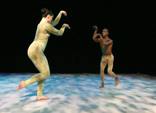 Lindsay Yoes (left) and Darrell Cleveland danced in the production of Mantis, a dance that explores the mating ritual of the praying mantis, during the South Dallas Dance Festival in 2007.