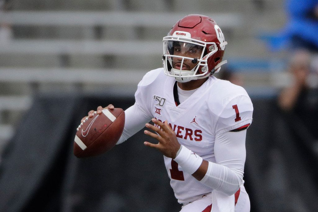 Oklahoma quarterback Jalen Hurts looks for a receiver during the first half of an NCAA college football game against Kansas Saturday, Oct. 5, 2019, in Lawrence, Kan.