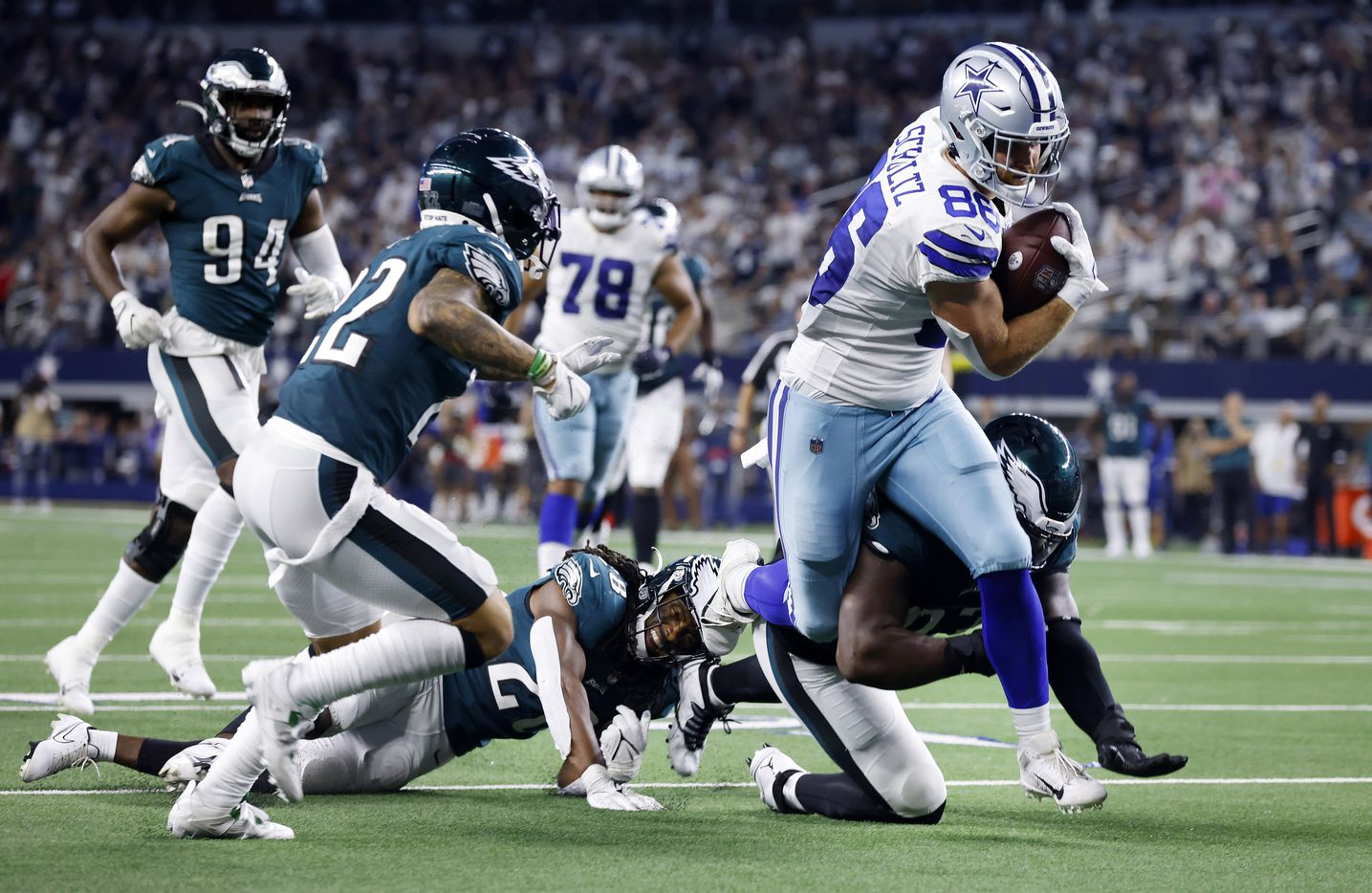 Dallas Cowboys tight end Dalton Schultz (86) breaks tackles as he scores following a fourth quarter completion against the Philadelphia Eagles defense at AT&T Stadium in Arlington, Monday, September 27, 2021. (Tom Fox/The Dallas Morning News)