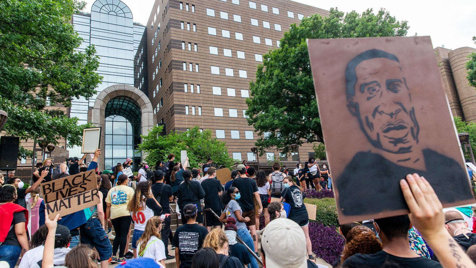 Protesters gather outside the Frank Crowley Courts Building past the city's 7 p.m. curfew, during a demonstration denouncing police brutality Monday, June 1, 2020, in Dallas.