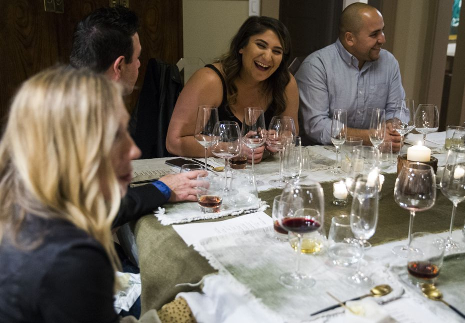 Guests (from left) Lindsey Charnay, Sammy Charnay, Christine Feghali and Eric Carlos chat between courses at a pop-up dinner hosted by chef Casey La Rue in Dallas.