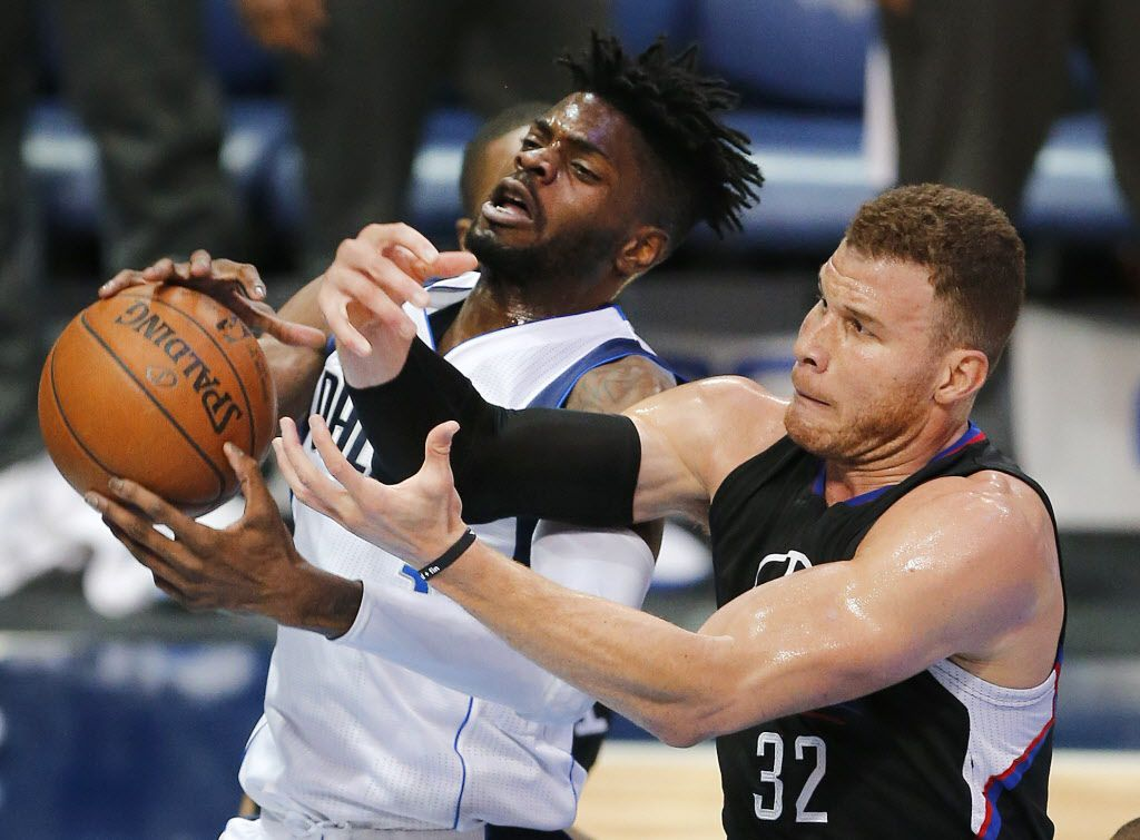 Dallas Mavericks forward Nerlens Noel (3) and LA Clippers forward Blake Griffin (32) battle for a rebound during the second quarter at the American Airlines Center, Thursday, March 23, 2017.