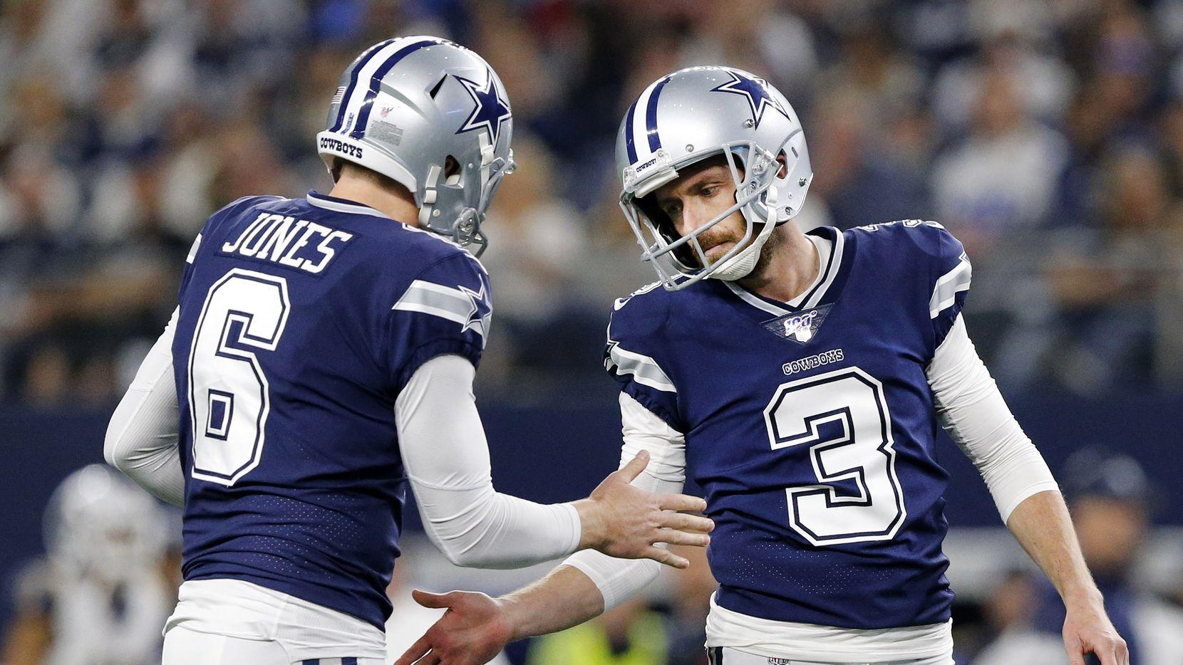 Dallas Cowboys holder Chris Jones (6) congratulates new kicker Kai Forbath (3) on his second half field goal against the Los Angeles Rams at AT&T Stadium in Arlington, Texas, Sunday, December 15, 2019.