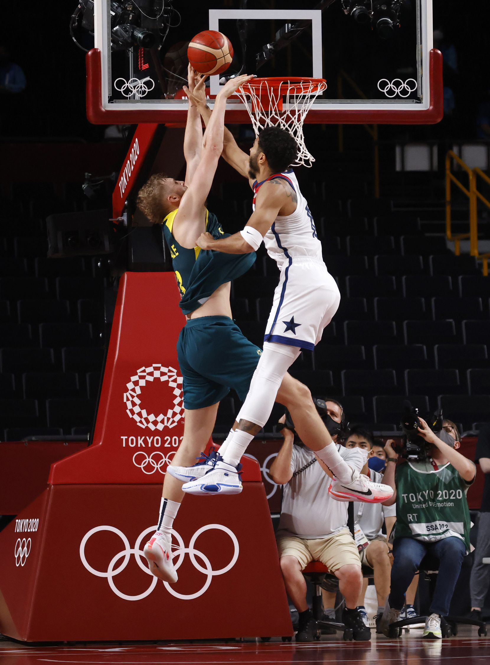 USA's Jayson Tatum (10) gets his hand on a shot by Australia's Jock Landale (13) during the second half of a men's basketball semifinal at the postponed 2020 Tokyo Olympics at Saitama Super Arena, on Thursday, August 5, 2021, in Saitama, Japan. USA defeated Australia 97-78 to advance to the gold medal game. (Vernon Bryant/The Dallas Morning News)