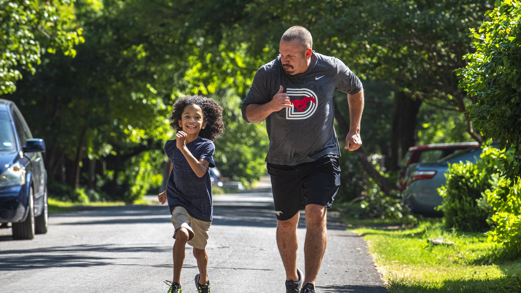 Scott Nady, Director of Recruiting for football at Southern Methodist University, runs with his son Max Nady, as the 11-year-old boy shows off his running skills, outside their home in Dallas, June 09, 2020. Max has cerebral palsy and the family was told he would likely be unable to walk after he was born. Ben Torres/Special Contributor