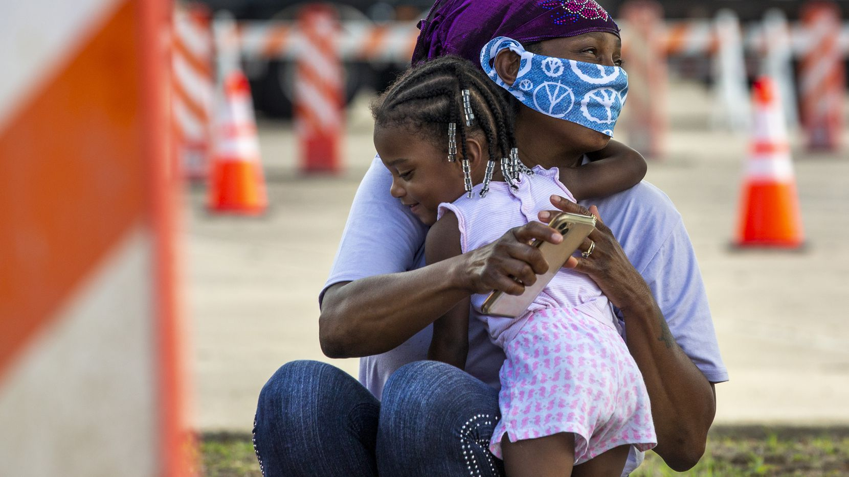"Tammy Washington gets a hug from her 2-year-old granddaughter, Aria, 2, as they and their family waits for a hotel voucher after driving all night from Orange, Texas, to reach the Mesquite Reception Center set up for hurricane evacuees on Wednesday. Weather forecasters have said Hurricane Laura is expected to make landfall in Southeast Texas and Western Louisiana at midnight on Thursday. ""There will be a lot of devastation,"" said Texas Governor Greg Abbott in a press conference."
