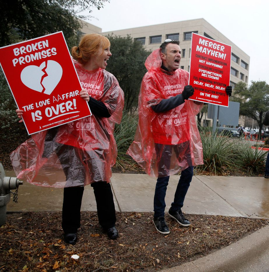 Bernadette Cassidy, flight attendant, (left) and Shane Staples, communications chairman for APFA protest the implementation of the FA contract and itchy uniforms at American Airlines headquarters in Fort Worth on February 14, 2017.  (Nathan Hunsinger/The Dallas Morning News)