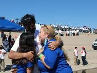 "Nodelia López, 60, hugs her son Ramón Hermosillo, 33, and her granddaughter Valentina, 11, during the ""Hugs Not Walls"" event Saturday on the banks of the Rio Grande, between El Paso and Ciudad Juárez."