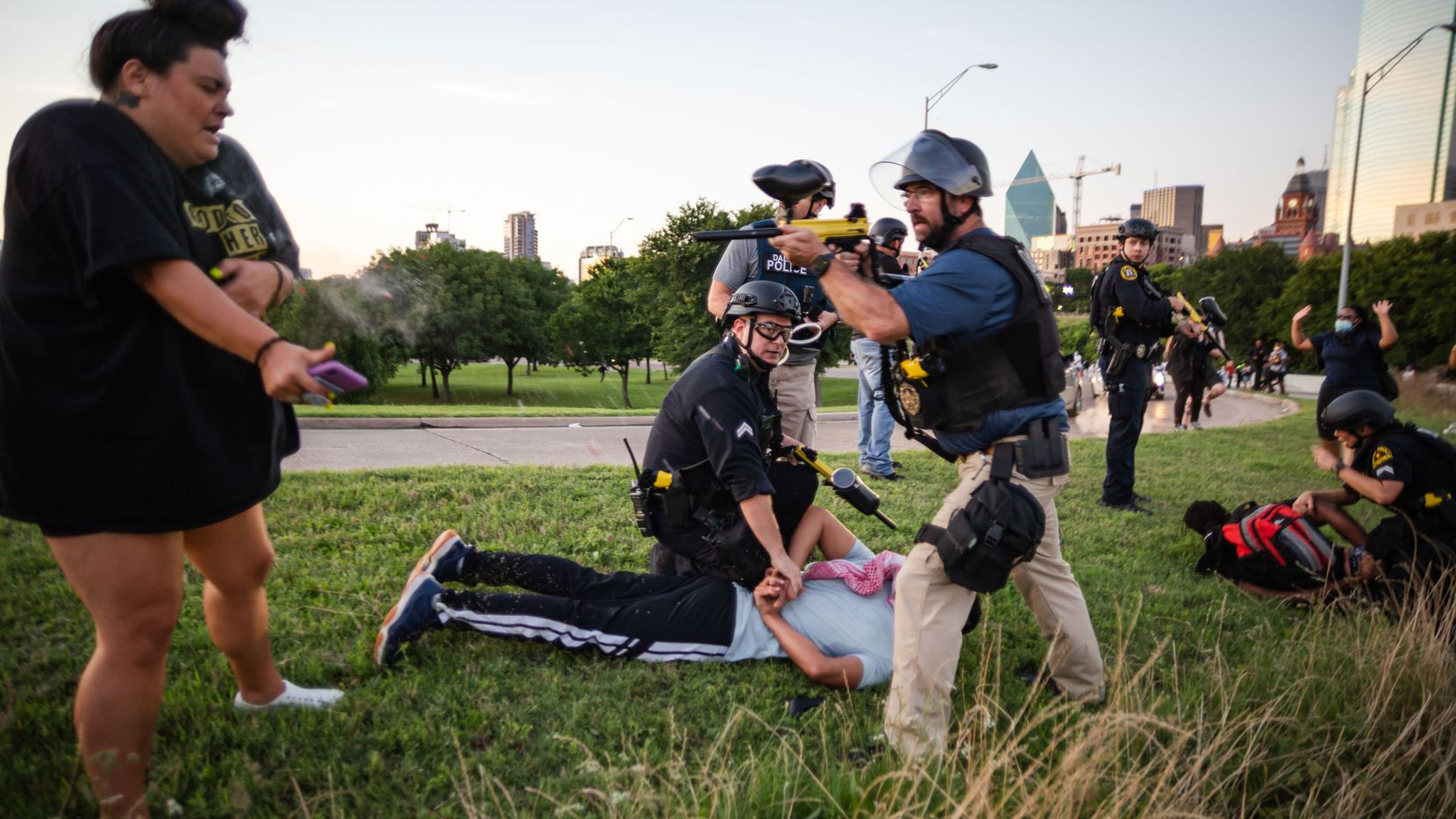 Dallas police Sgt. Roger Rudloff fires pepper balls at a protester standing only a few feet away. The incident occurred just before dusk on May 30 during protests in downtown Dallas sparked by George Floyd's death five days earlier.