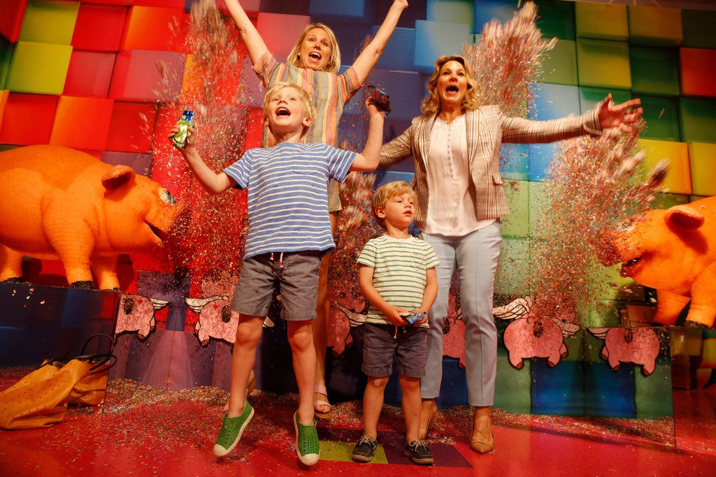 That's Dallas city council member Jennifer Gates (far right), her daughter Jessica Whitsitt and sons Gambill Whitsitt, 5, and Gates Whitsitt, 3, at Candytopia. The pigs flanking the confetti blast are covered in gummy candies.