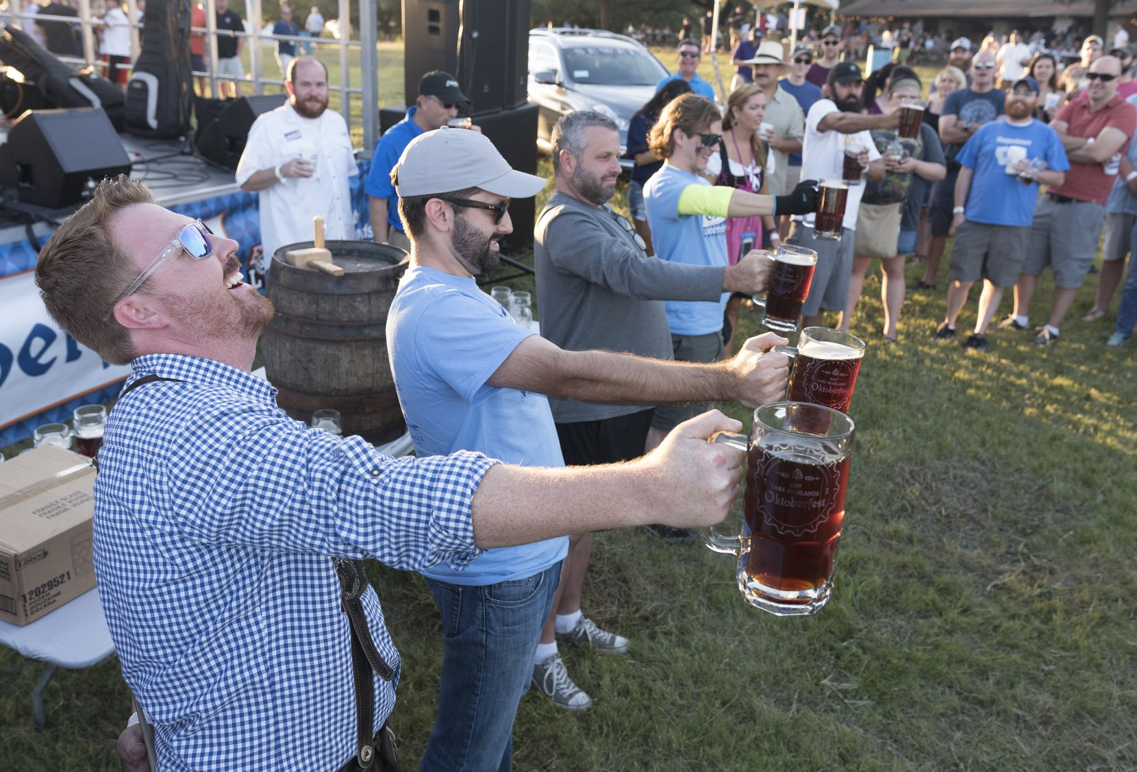 Contestants compete in a stein holding contest during the 2017 Oktoberfest Dallas. The 2021 event will be held Sept. 2 at Flag Pole Hill Park.    (Rex C. Curry/Special Contributor)