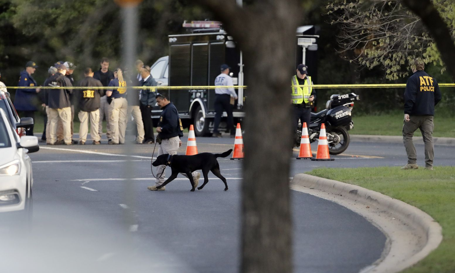 Officials work and stage near the site of Sunday's deadly explosion.