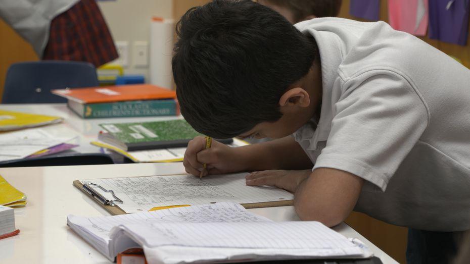 Good Shepherd Episcopal School third-grader Ahan Jain writes to his pen pal Nancy Miller, a resident at Presbyterian Village North in Dallas. (Tommy Noel/Staff photographer)