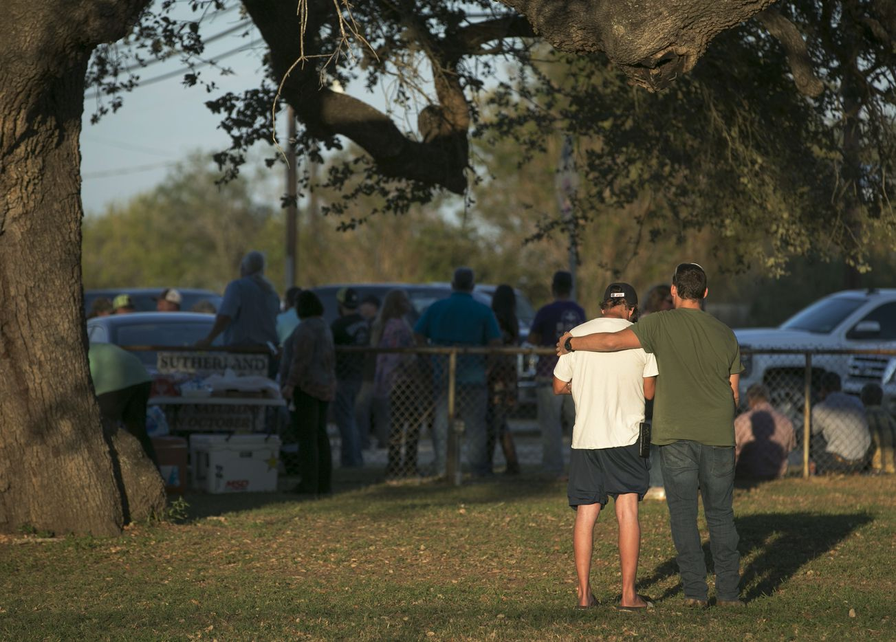 People comfort each other at a community center near the scene of a deadly shooting at the First Baptist Church in Sutherland Springs, Texas, Sunday, Nov. 5, 2017.