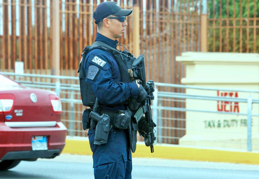 A Customs and Border Protection Special Response Team member patrols at the Hidalgo-Reynosa International Bridge in Hidalgo, in Texas' Rio Grande Valley.