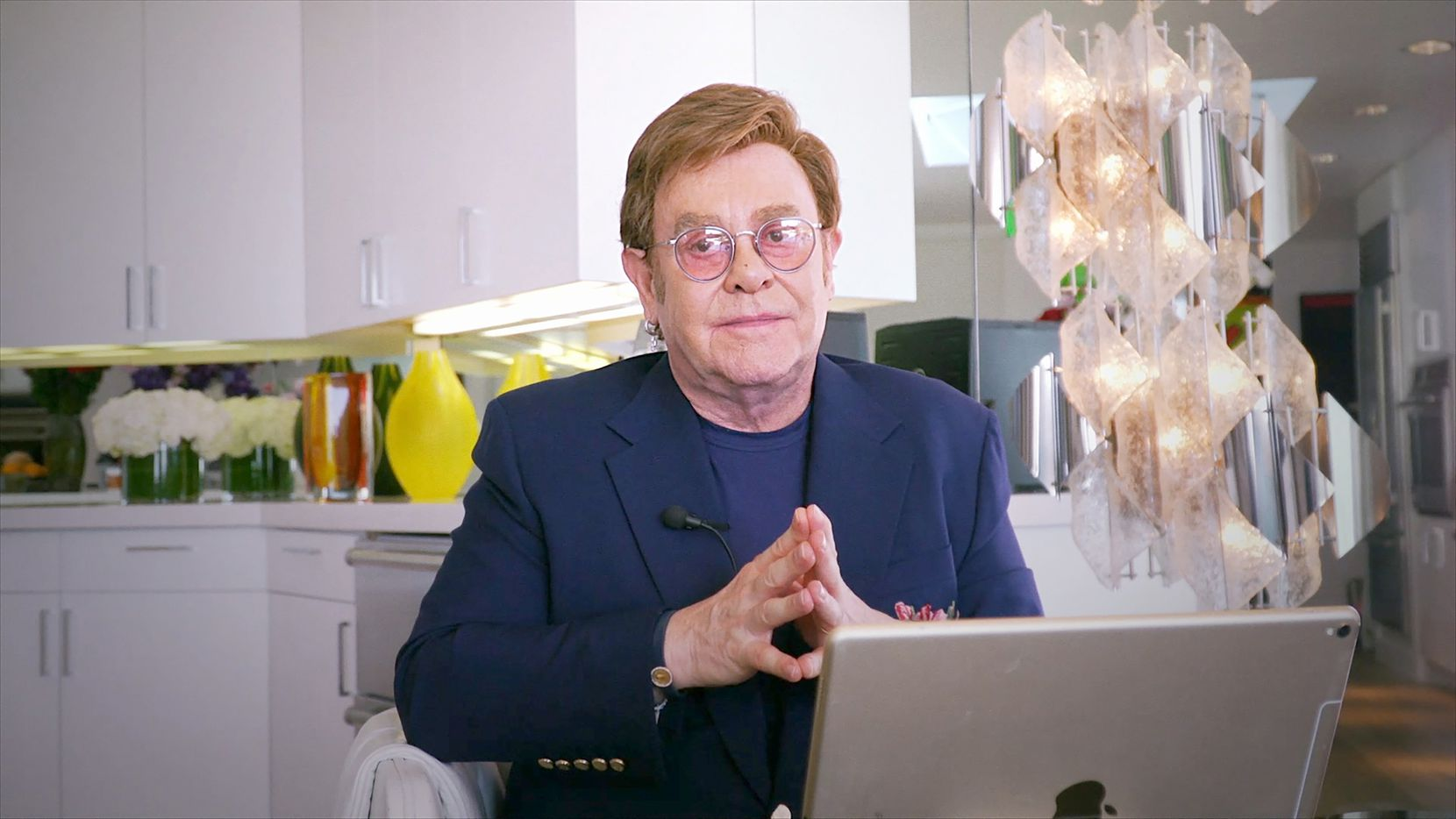 """Elton John appears during the """"Fox Presents the iHeart Living Room Concet for America,"""" a music event to provide entertainment relief and support for Americans to help fight the spread of the COVID-19 virus."""