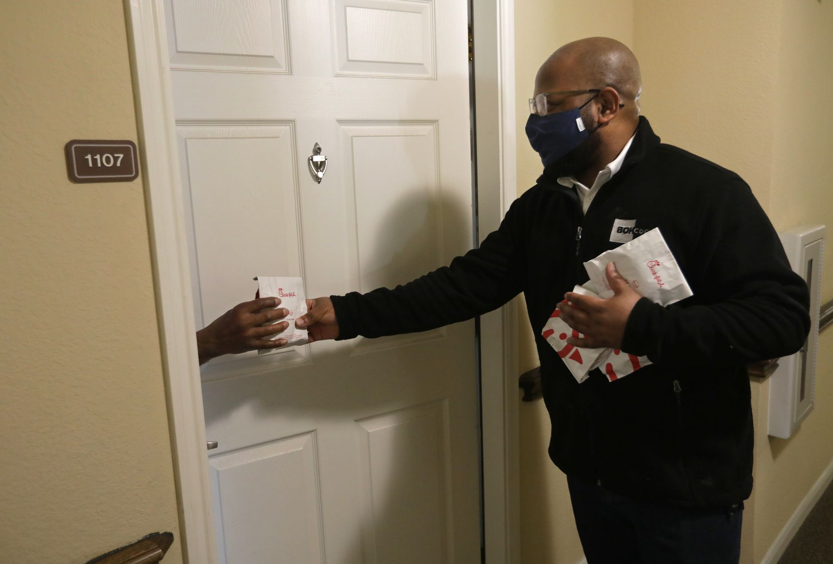"Ten years ago, James Armstrong III's grandfather gave him some advice. ""He urged me to never waste an experience, either good or bad,"" Armstrong says. Armstrong, president and CEO of Builders of Hope Community Development Corp. as well as lead pastor at The Community Fellowship Church Dallas, is pictured delivering food recently at a Dallas senior housing complex."