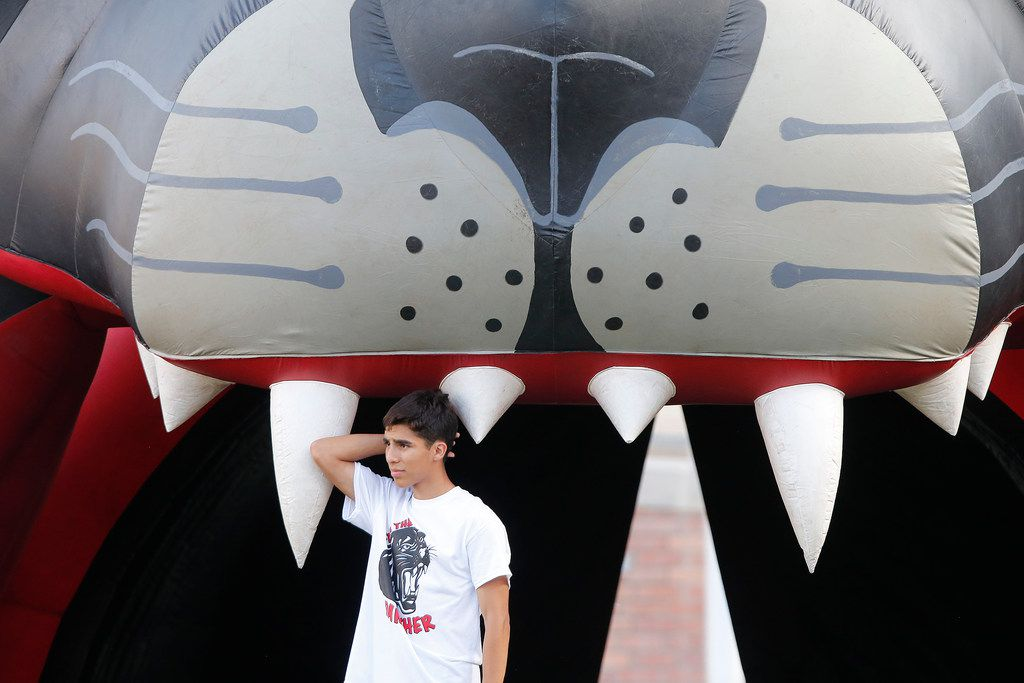 Colleyville Heritage student Nathan Yanes, 15, stands under the inflatable panther before kickoff as Colleyville Heritage High School hosted Lovejoy High School as part of the Tom Landry Classic at Eagle Stadium in Allen on Saturday, August 31, 2019. (Stewart F. House/Special Contributor)