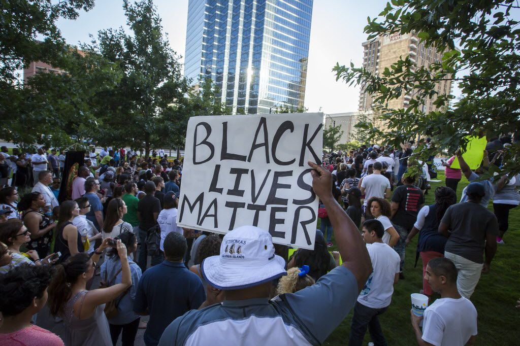 """Ferelle Woodhouse holds a """"Black Lives Matter"""" sign joins other protestors at a rally in downtown Dallas on Thursday, July 7, 2016. Dallas protestors rallied in the aftermath of the killing of Alton Sterling by police officers in Baton Rouge, Louisiana and Philando Castile, who was killed by police less than 48 hours in Minnesota. (Smiley N. Pool/The Dallas Morning News)"""