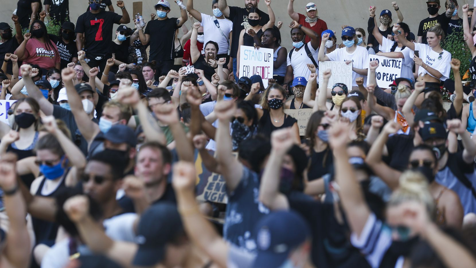 Protesters gathered at Dallas City Hall for an 8-minute, 46-second period of silence after marching from Klyde Warren Park during a demonstration against police brutality on June 6. Some people wore masks, but there was little social distancing.