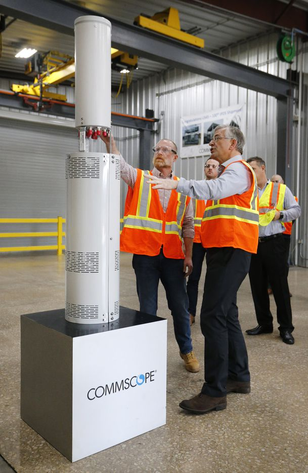 Federal Communications Commission commissioner Brendan Carr (left) tours wireless infrastructure manufacturer CommScope in Euless, Texas, Monday, February 4, 2019 with vice president of site solutions Mike Fabbri. Here Mike talks about their new integrated pole boxes and antennas for new 5G technology being deployed in the Dallas area.
