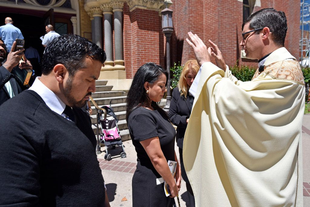 Democratic state Rep. Victoria Neave of Dallas received a blessing after Mass on Sunday from the Rev. Edward Bentley outside the Cathedral Shrine of the Virgin of Guadalupe in downtown Dallas. Neave began her fast after church and plans to continue it through Wednesday. (Ben Torres/Special Contributor)