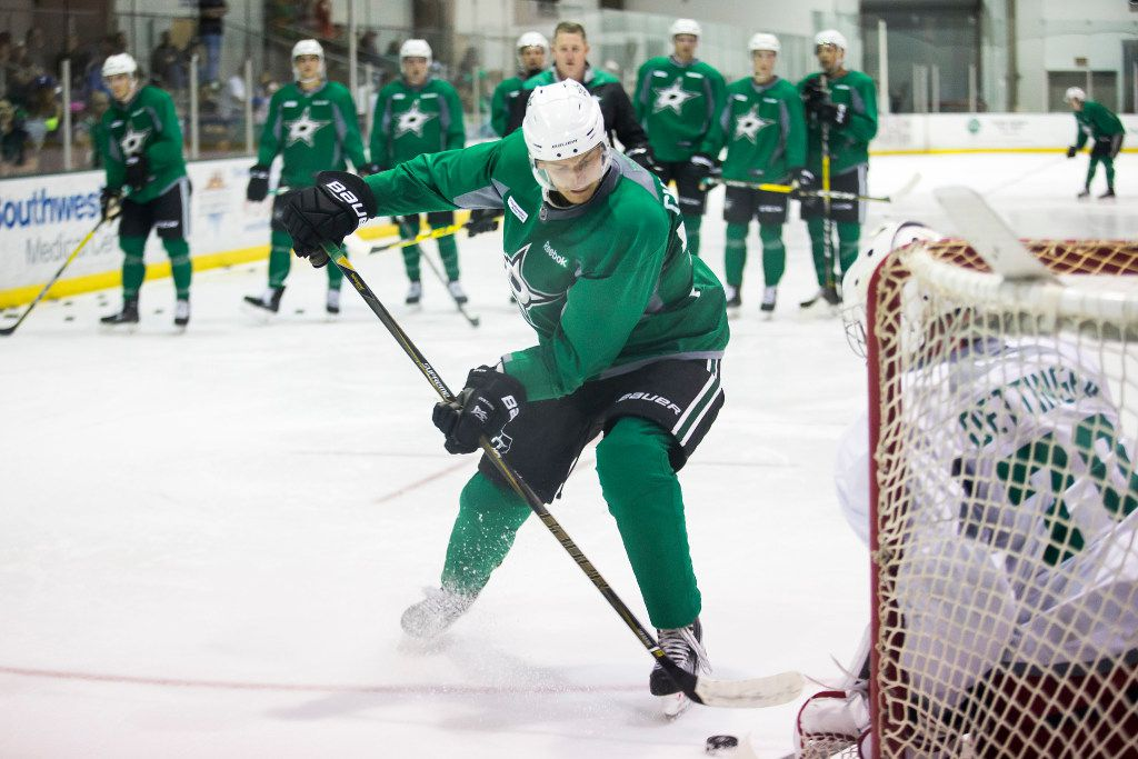 FILE - Forward Denis Gurianov works against goalie Jake Oettinger on the first day of Stars development camp at the Dr Pepper StarCenter on Saturday, July 8, 2017, in Frisco.