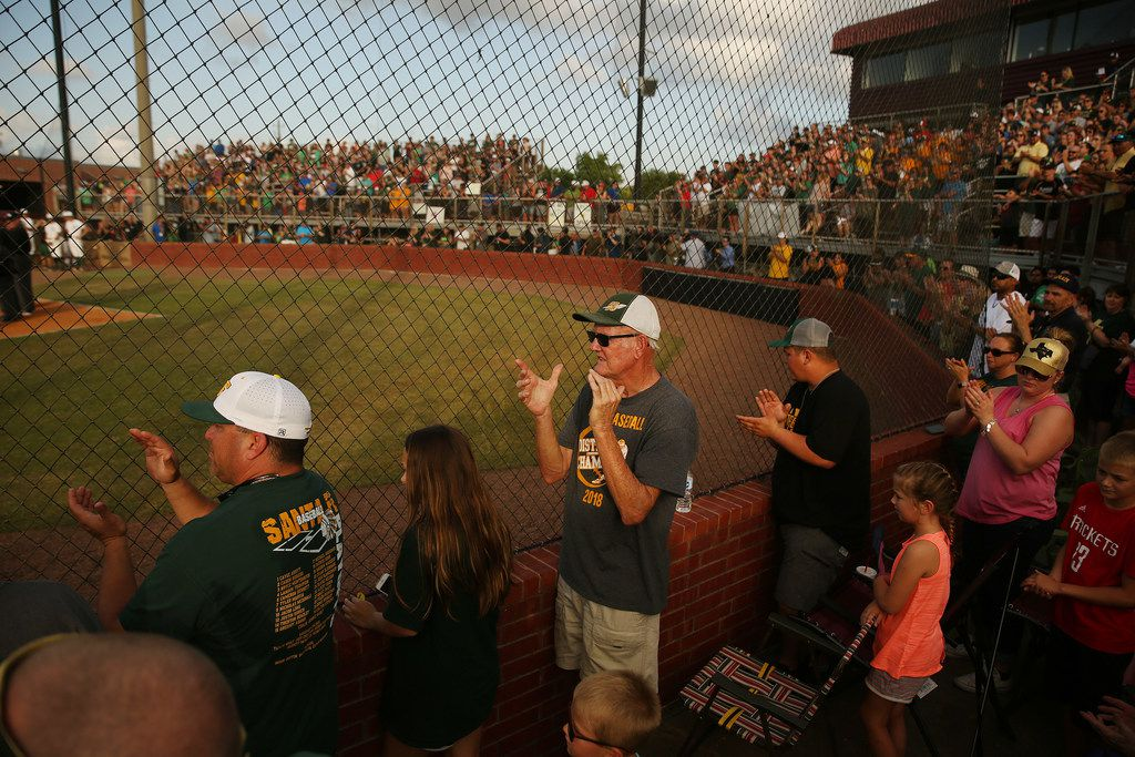Santa Fe supporters applaud as players are introduced before the second game of the best-of-three series in the Class 5A Region III playoff high school baseball game between Santa Fe and Kingwood Park at Jim Kethan Field at Deer Park High School in Deer Park, TX Saturday May 19, 2018. On Friday morning, 10 people were killed and 13 were injured after a shooting at Santa Fe High School. The game was postponed to Saturday after it was scheduled for Friday. Dimitrios Pagourtzis was booked into the Galveston County Jail on capital murder charges.