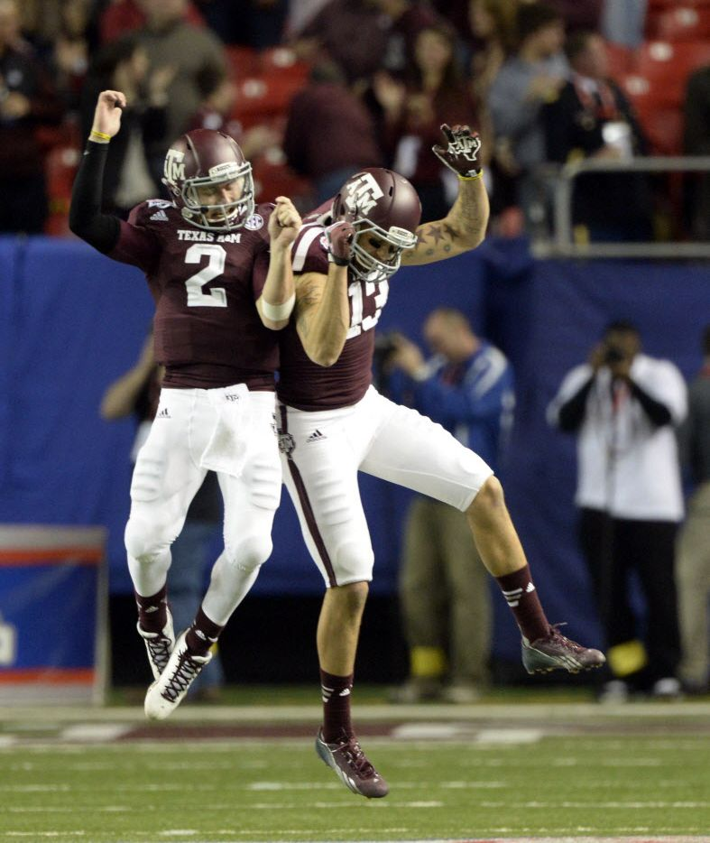 Texas A&M Aggies quarterback Johnny Manziel (2) celebrates with wide receiver Mike Evans (13) in the fourth quarter against the Duke Blue Devils in the 2013 Chick-fil-a Bowl at the Georgia Dome. (John David Mercer-USA TODAY Sports)